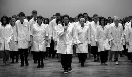 Marina leads the exercise at the Whitworth Gallery in Manchester, England in 2009 (© Marco Anelli via marinaabramovicinstitute.org)
