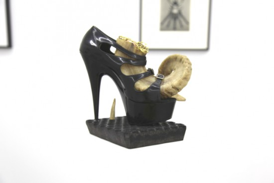"BREYER P-ORRIDGE Shoe Horn #3, 2014 Ram horn, shoe worn by Genesis as ""Lady Sarah"" (her dominatrix persona), sting ray skin, ermine fur, bone,  Nepalese fabric-printing square, brass netting, copper ball, 9.25 x 9 x 8 inches"