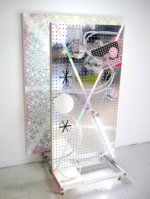 Bradley Wester  Twin Peaks (Pink), 2014 Archival digital canvas painting and print, Mylar coated pegboard, pipe cleaners, foiled bubble wrap, mirrors, cable ties, metal hardware, aluminum tube, Butt calendar image, holographic and glitter tape, mirror balls, wood, glitter, acrylic, fluorescent lamps, extruded aluminum