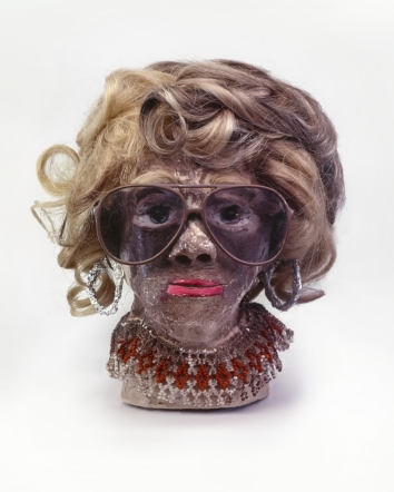 "James 'Son Ford' Thomas, Untitled, 1987, 11.5"" height Unfired clay, artificial hair, sunglasses, wire, aluminum foil, beads, glass marbles, paint Courtesy of William S. Arnett Collection of the Souls Grown Deep Foundation"