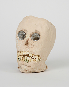 "James 'Son Ford' Thomas, Untitled, Date unknown, 7.5 x 5.5 x 4.5"" Unfired clay, aluminum foil, human teeth Photograph by Marie Catalano Courtesy of Thomas E. Scanlin Collection"