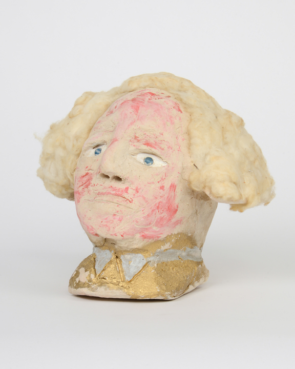"""James 'Son Ford' Thomas, Untitled, Date unknown, 7.5 x 3.5 x 7.5"""" Unfired clay, paint, cotton, glass marbels  Photograph by Marie Catalano  Courtesy of Souls Grown Deep Foundation"""