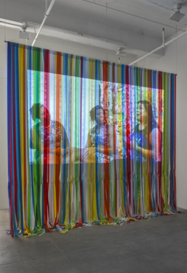 Andrea Bowers, Roundtable Discussion, 2016 Single channel HD video projection (color, sound; 30 minutes, looped), ribbon projection screen