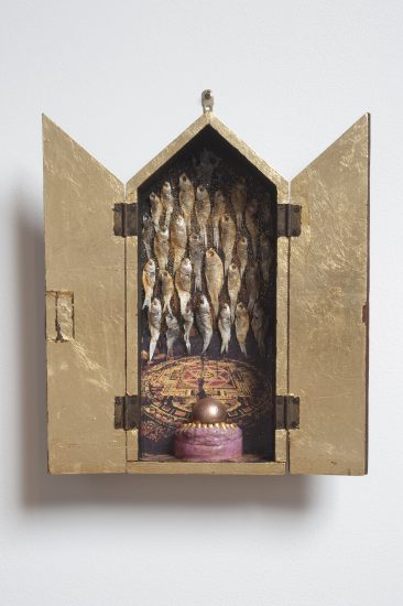 Genesis Breyer P-Orridge, Feeding the Fishes, 2010, fish, glitter, photos, tooth mold, copper ball, found wood box (Courtesy the artists and Invisible-Exports, New York)