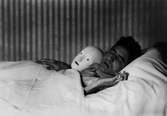 Berenice Abbott, Cocteau in Bed With Mask, Paris, 1927, gelatin silver print