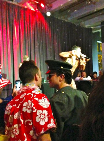 'Hawaiian Elvis' and 'Soldier Elvis' watching El Vez' performance