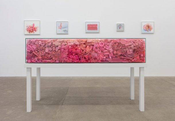"Portia Munson, ""Her Coffin"", 2016, found pink plastic, tempered glass and recycled wood table (Courtesy the artist and PPOW Gallery)"