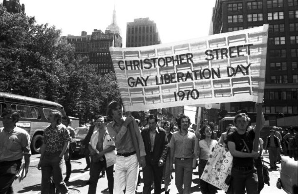 Men hold a banner during Christopher Street Liberation Day, 1970.
